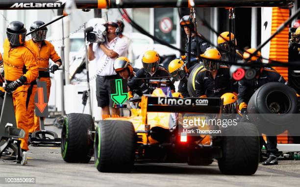 Fernando Alonso of Spain driving the McLaren F1 Team MCL33 Renault makes a pit stop for new tyres during the Formula One Grand Prix of Germany at...