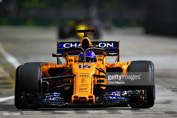 Fernando Alonso of Spain driving the McLaren F1 Team MCL33 Renault on track during the Formula One Grand Prix of Singapore at Marina Bay Street...
