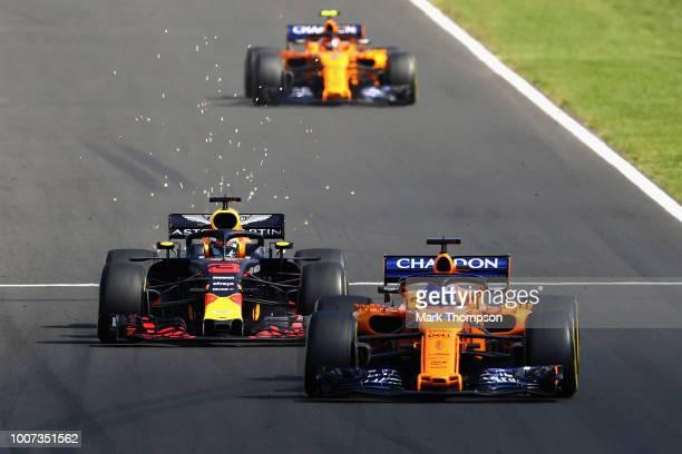 Fernando Alonso of Spain driving the McLaren F1 Team MCL33 Renault leads Daniel Ricciardo of Australia driving the Aston Martin Red Bull Racing RB14...