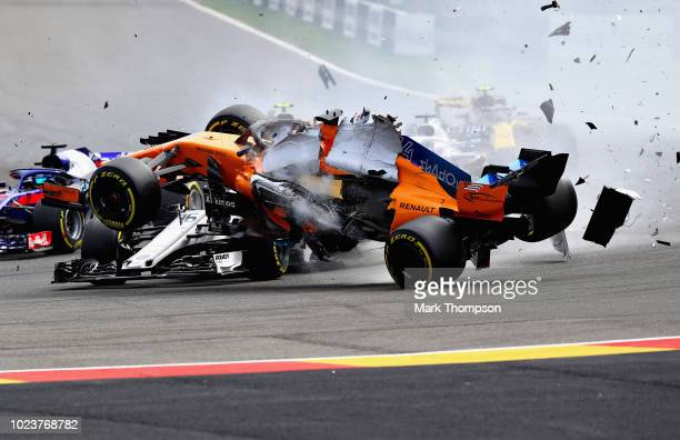 Fernando Alonso of Spain driving the McLaren F1 Team MCL33 Renault launches over the top of Charles Leclerc of Monaco driving the Alfa Romeo Sauber...