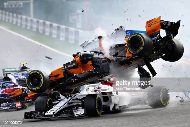 Fernando Alonso of Spain driving the McLaren F1 Team MCL33 Renault crashes with Charles Leclerc of Monaco driving the Alfa Romeo Sauber F1 Team C37...