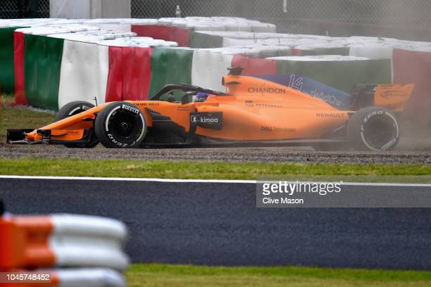 Fernando Alonso of Spain driving the McLaren F1 Team MCL33 Renault spins during practice for the Formula One Grand Prix of Japan at Suzuka Circuit on...