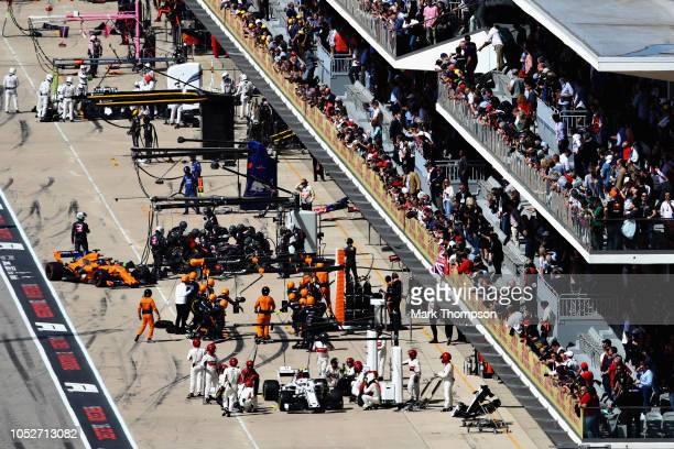 Fernando Alonso of Spain driving the McLaren F1 Team MCL33 Renault makes pit stop for new tyres during the United States Formula One Grand Prix at...