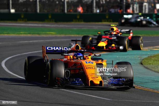 Fernando Alonso of Spain driving the McLaren F1 Team MCL33 Renault leads Max Verstappen of the Netherlands driving the Aston Martin Red Bull Racing...
