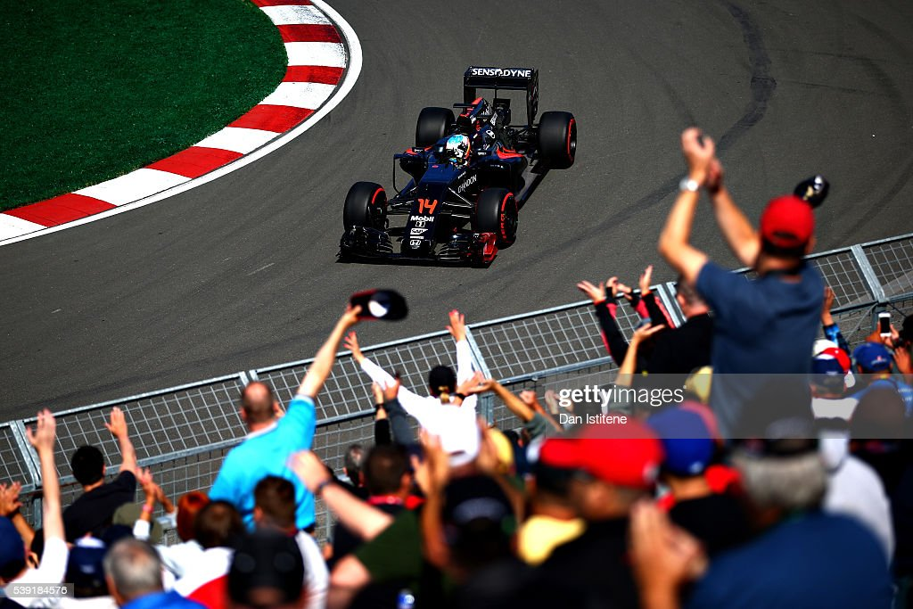 Fernando Alonso of Spain driving the (14) McLaren Honda Formula 1 Team McLaren MP4-31 Honda RA616H Hybrid turbo waves at the crowd on track during practice for the Canadian Formula One Grand Prix at Circuit Gilles Villeneuve on June 9, 2016 in Montreal, Canada.
