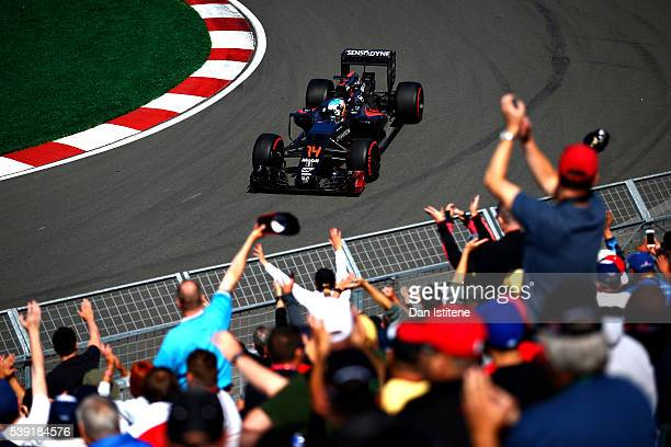 Fernando Alonso of Spain driving the McLaren Honda Formula 1 Team McLaren MP431 Honda RA616H Hybrid turbo waves at the crowd on track during practice...