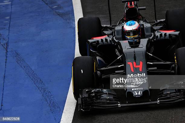 Fernando Alonso of Spain driving the McLaren Honda Formula 1 Team McLaren MP431 Honda RA616H Hybrid turbo in the Pitlane during final practice for...