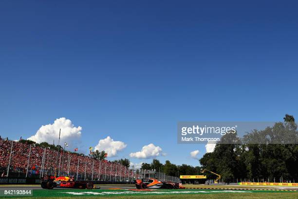 Fernando Alonso of Spain driving the McLaren Honda Formula 1 Team McLaren MCL32 leads Max Verstappen of the Netherlands driving the Red Bull Racing...