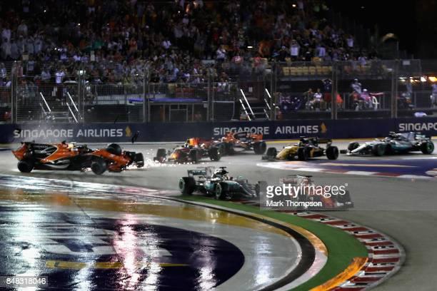 Fernando Alonso of Spain driving the McLaren Honda Formula 1 Team McLaren MCL32 Kimi Raikkonen of Finland driving the Scuderia Ferrari SF70H and Max...