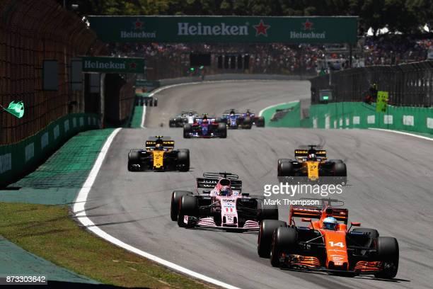 Fernando Alonso of Spain driving the McLaren Honda Formula 1 Team McLaren MCL32 leads Sergio Perez of Mexico driving the Sahara Force India F1 Team...