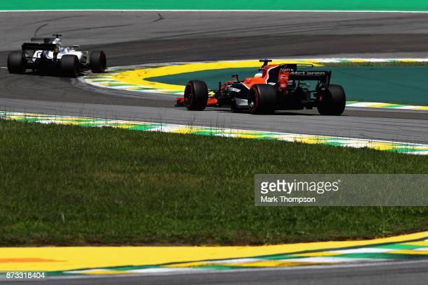 Fernando Alonso of Spain driving the McLaren Honda Formula 1 Team McLaren MCL32 follows Felipe Massa of Brazil driving the Williams Martini Racing...