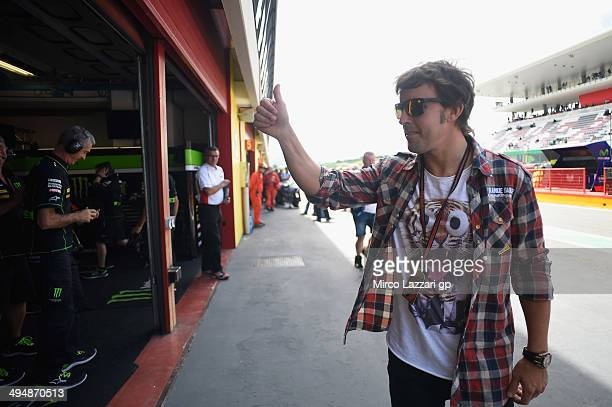 Fernando Alonso of Spain greets in pit during the MotoGP during the MotoGp of Italy Qualifying at Mugello Circuit on May 31 2014 in Scarperia Italy