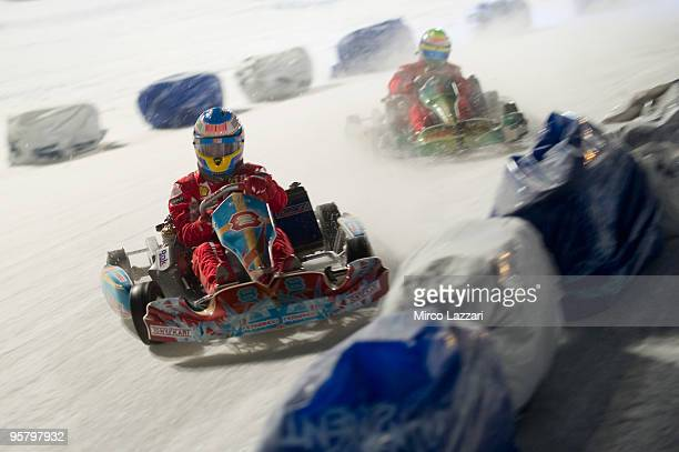 Fernando Alonso of Spain leads Felipe Massa of Brasil and Scudera Ferrari Marlboro during the kart race of the 'Chellenge Exibition' during the 2010...