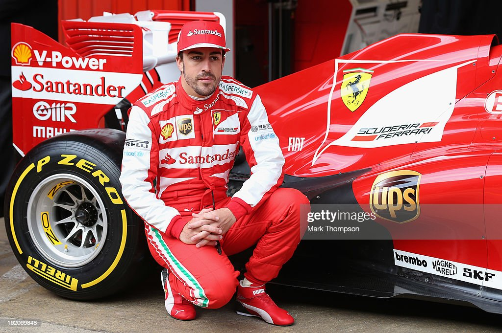Fernando Alonso of Spain reveals the UPS Shield on the Ferrari F138 in the Barcelona pitlane to unveil Scuderia Ferrari new team sponsor UPS before starting his 2013 on-track test programme at the Circuit de Catalunya on February 19, 2013 in Barcelona, Spain.
