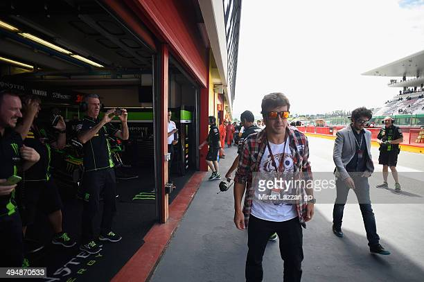 Fernando Alonso of Spain walks in pit during the MotoGP during the MotoGp of Italy Qualifying at Mugello Circuit on May 31 2014 in Scarperia Italy