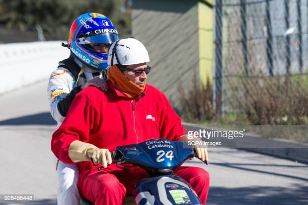 CIRCUIT MONTMELO CATALONIA SPAIN Fernando Alonso of Team McLarenHonda McLaren MCL33 go back to the box on a motorbike after his car's motor broke...