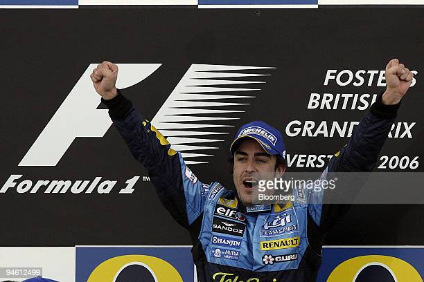 Fernando Alonso of Team Renault is seen on the winners podium after winning the Formula 1 GP of Great Britain in Silverstone UK Sunday June 11 2006