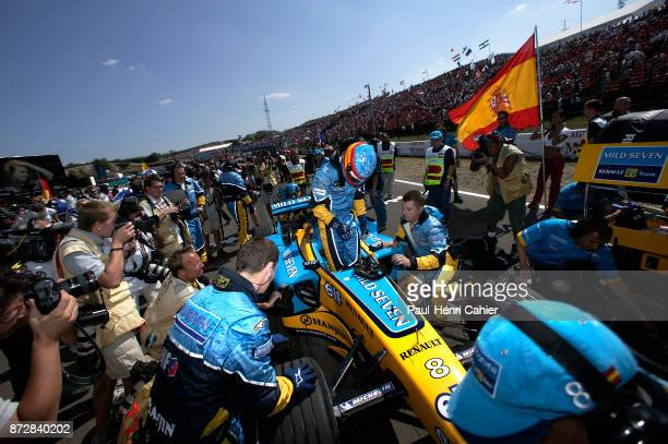 Fernando Alonso Renault R23B Grand Prix of Hungary Hungaroring 24 August 2003 Ferando Alonso climbing out of his car on the starting grid of the 2003...