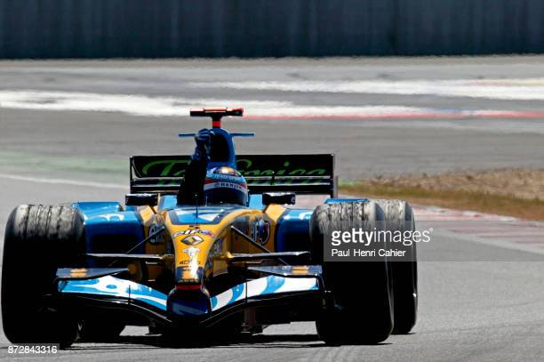 Fernando Alonso Renault R25 Grand Prix of France Circuit de Nevers MagnyCours 03 July 2005 Fernando Alonso victorious raises his arm after the finish...
