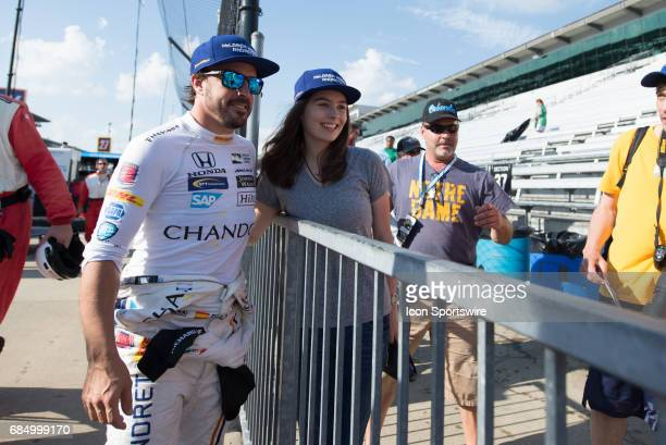 Fernando Alonso taking a photo with a fan following the fourth day of practice for the 101st Indianapolis on May 18 at the Indianapolis Motor...