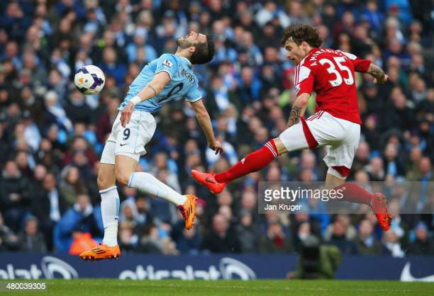 Fernando Amorebieta of Fulham fouls Alvaro Negredo of Manchester Cit in the area during the Barclays Premier League match between Manchester City and...