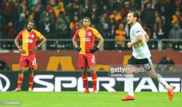 Fernando and Luyindama of Galatasaray react during the UEFA Europa League Round of 32 match between Galatasaray and Benfica at the Turk Telekom...