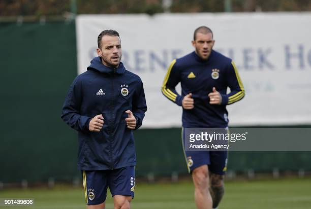Fernando and Saldado of Fenerbahce attend a training session ahead of the 2nd half of Turkish Super Lig at Belek Tourism Center in Serik district of...
