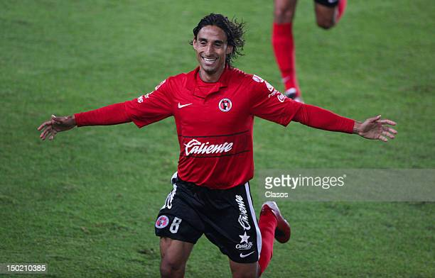 Fernando Arce of Tijuana celebrates a goal during the match of soccer between Pachuca vs Tijuana as part of the Torneo Apertura 2012 at Hidalgo...