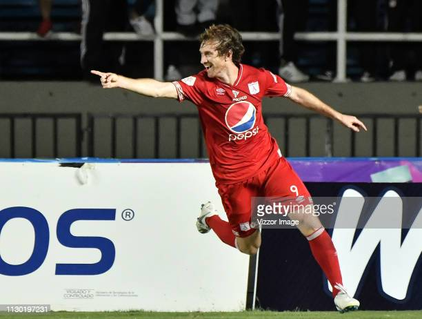 Fernando Aristeguieta of America celebrates after scoring the third goal of his team during a match between America de Cali and Medellin as part of...