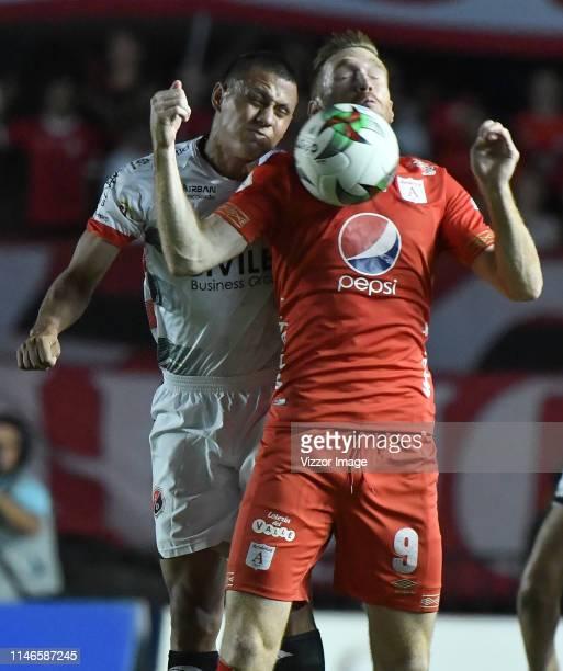 Fernando Aristeguieta of America struggles the ball with Matias Perez Garcia of Cucuta during the match between America de Cali and Cucuta Deportivo...