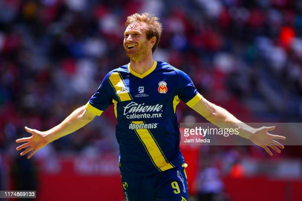 Fernando Aristeguieta of Morelia celebrates after scoring the second goal of his team during the 9th round match between Toluca and Morelia as part...