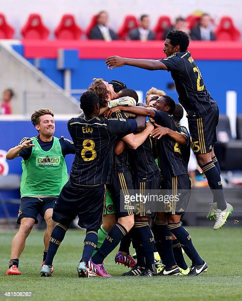Fernando Aristeguieta of Philadelphia Union is swarmed by teammates after he scored the game winning penalty shot against the New York Red Bulls...