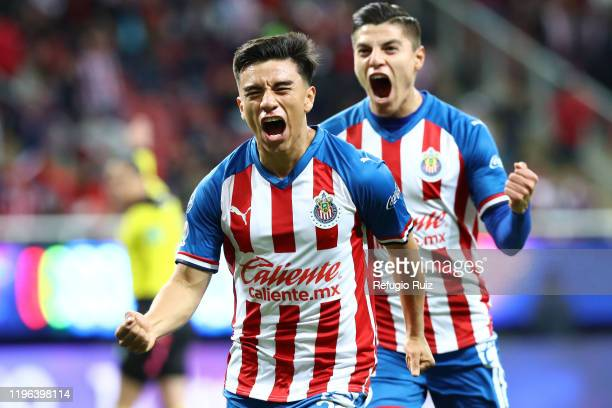 Fernando Beltrán of Chivas celebrates with his teammates after scoring the first goal of his team during the 3rd round match between Chivas and...