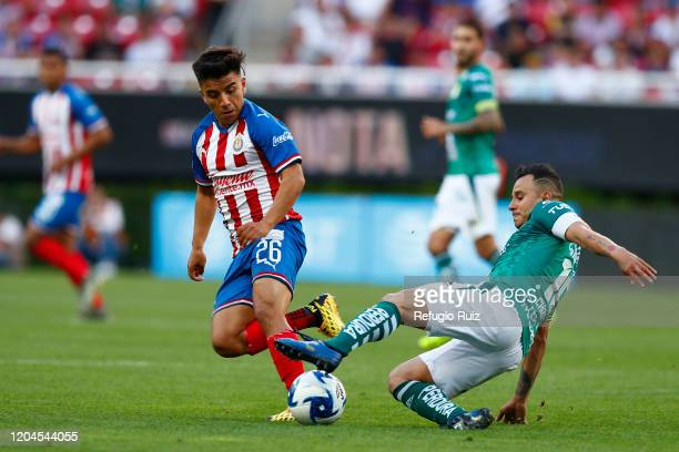 Fernando Beltrán of Chivas fights for the ball with Luis Montes of Leon during the 8th round match between Chivas and Leon as part of the Torneo...