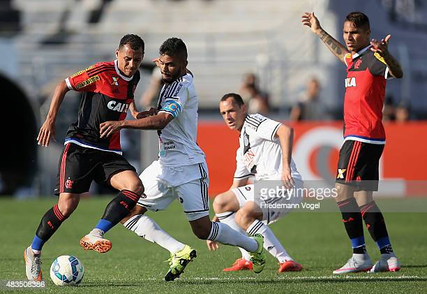 Fernando Bob and Josimar of Ponte Preta fights for the ball with Guerrero and Alan Patrick of Flamengo during the match between Ponte Preta and...