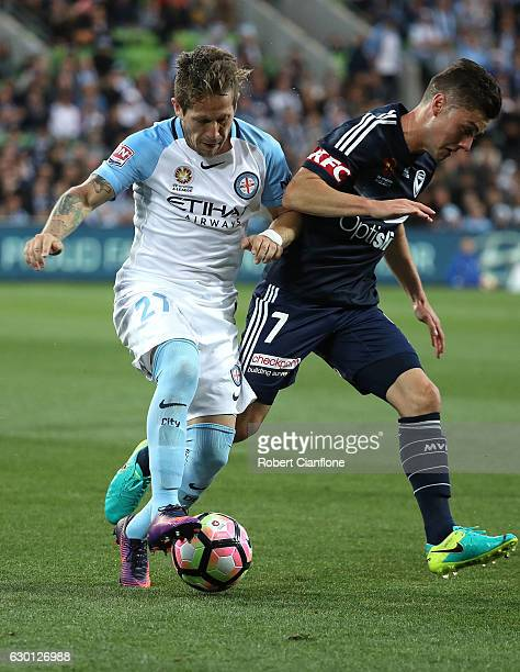 Fernando Brandan of Melbourne City is challenged by Marco Rojas of the Victory during the round 11 ALeague match between Melbourne City FC and...