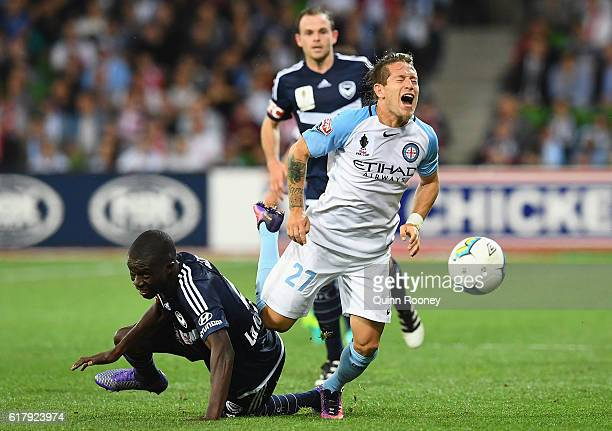 Fernando Brandan of the City is tackled by Jason Geria of the Victory during the FFA Cup Semi Final match between Melbourne City FC and Melbourne...