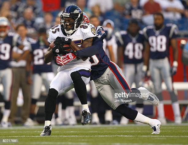 Fernando Bryant of the New England Patriots tackles Tom Zbikowski of the Baltimore Ravens during the preseason game at Gillette Stadium on August 7...