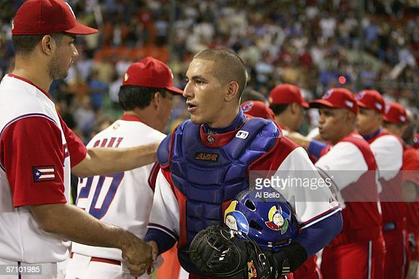 Fernando Cabrera of Puerto Rico shakes hands with Ariel Pestano of Cuba after their game in Round 2 of the World Baseball Classic on March 15 2006 at...