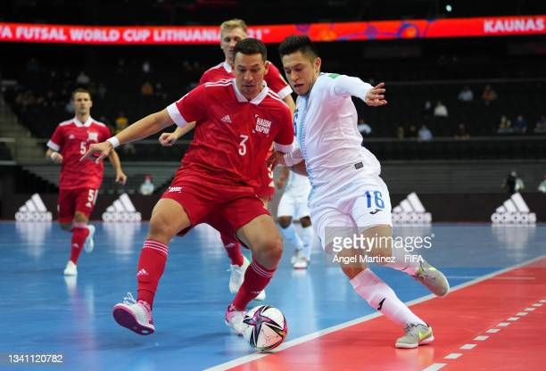Fernando Campaignac of Guatemala and Romulo of RFU challenge for the ball during the FIFA Futsal World Cup 2021 group B match between Guatemala and...