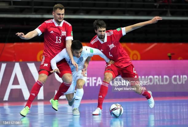 Fernando Campaignac of Guatemala challenge for the ball with Ivan Chishkala of RFU and Artem Antoshkin of RFU during the FIFA Futsal World Cup 2021...