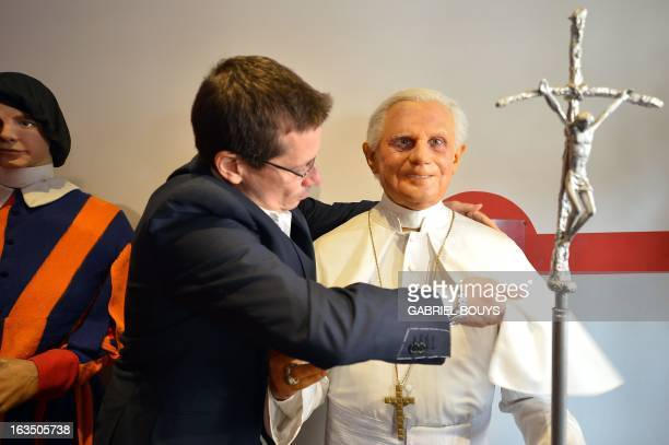 Fernando Canini administrator of Rome wax museum take care of the statue of Pope Benedict XVI at the museum on March 11 2013 in Rome Catholic...