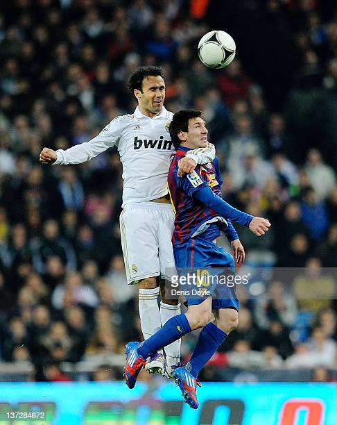 Fernando Carvalho of Real Madrid tackles Lionel Messi of Barcelona during the Copa del Rey Quarter Finals match between Real Madrid and Barcelona at...