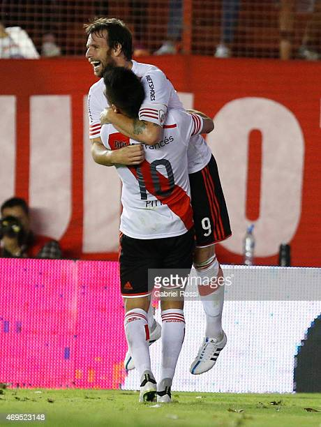 Fernando Cavenaghi of River Plate and teammate Gonzalo Martinez celebrate their team's first goal during a match between Argentinos Juniors and River...