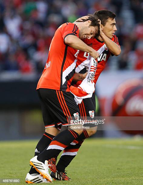 Fernando Cavenaghi of River Plate celebrates with Bruno Urribarri after scoring the first goal of his team during a match between Banfield and River...