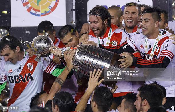 Fernando Cavenaghi of River Plate holds the trophy as he celebrates with his teammates after winning a final match between River Plate and Tigres...