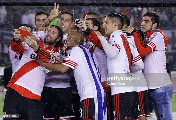 Fernando Cavenaghi of River Plate takes a selfie with his teammates after winning a second leg final match between River Plate and Tigres UANL as...