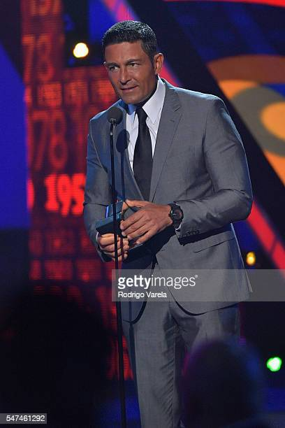 Fernando Colunga speaks onstage during the Univision's 13th Edition Of Premios Juventud Youth Awards at Bank United Center on July 14 2016 in Miami...