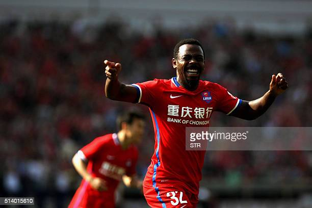 Fernando Conceio of Chongqing Lifan celebrates after scoring a goal during a Chinese Super League football match against Guangzhou Evergrande in...