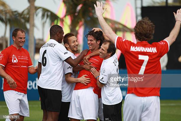 Fernando Couto celebrates with other players after scoring the winning goal during the Laureus Football Challenge presented by IWC Schaffhausen as...